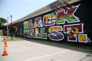 Image shows a panorama of the mural commemorating Black Wall Street in Greenwood, Oklahoma, taken shortly after its completion in 2018.