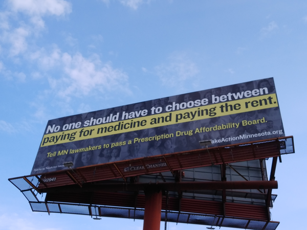 """Billboard that says """"No one should have to choose between paying for medicine and paying the rent. Tell MN lawmakers to pass a Prescription Drug Affordability Board."""""""