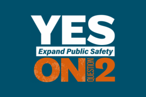 Yes 4 Minneapolis logo: Yes on Question 2, expand public safety. Orange and white graphic on blue background.
